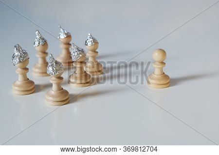 Group Of Pawn Chess Pieces With Tinfoil Hats Against Imagined Heteronomy Stand Towards A Piece Witho