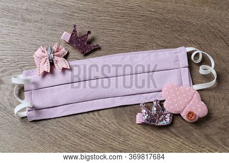 Homemade Protective Mask And Adorable Girly Hair Clips On Wooden Background, Flat Lay. Sewing For Ch