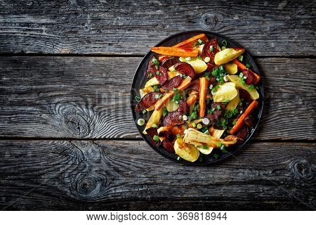 Vegetables Roasted In The Oven, Sliced Beetroot, Potato Wedges, Parsnip, Carrots Sprinkled With Chop