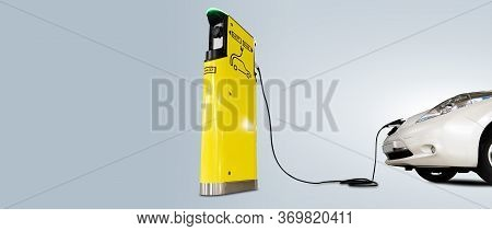 Charging Electric Car Isolated On Grey Background
