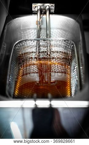 Cooking Oil Sitting In A Commercial Deep Fryer