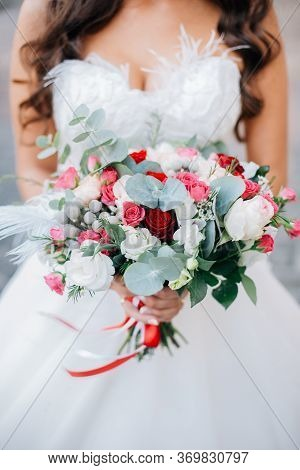 Wedding Bouquet Of Flowers Held By Bride Closeup