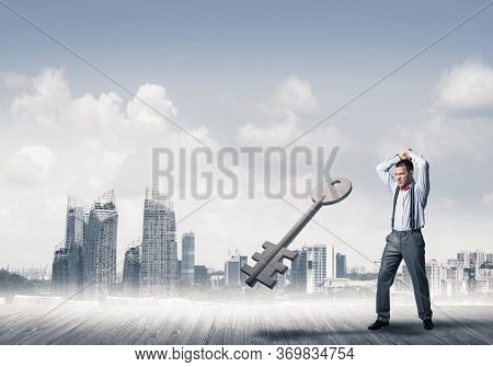 Determined Businessman Against Modern Cityscape Breaking With Hands Stone Key Figure