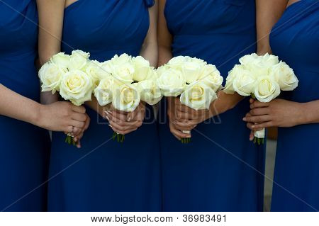 Four Bridesmaids Holding White Rose Wedding Bouquets