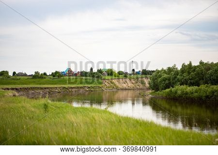 The Village Stands On A Hill Near The Tara River, Omsk Region, Siberia. Private Homes, Rural Area Ne