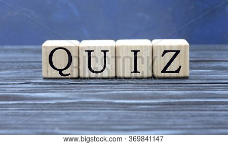 Concept Word Quiz On Cubes On A Beautiful Gray Blue Background