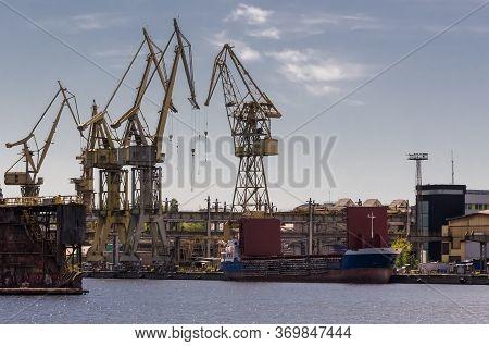 Shipyard - Repair Dock And Port Cranes At The Shipyard Quays