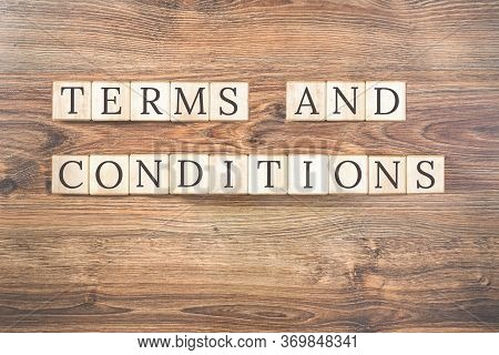 Terms And Conditions Text On Wooden Background. Business Concept. Terms And Conditions Of Service Wi