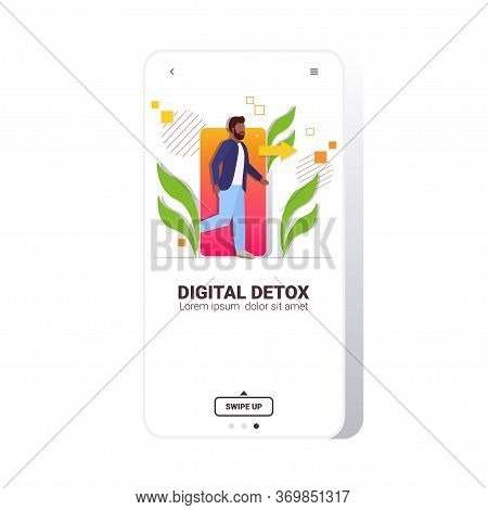Man Coming Out Of Cellphone Digital Detox Concept Guy Escaping From Digital Addiction Abandoning Int