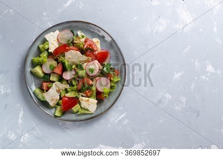 Fattoush Vegetarian Salad In A Gray Plate On A Gray Background. Copy Space. Top View. Levantine Fatt