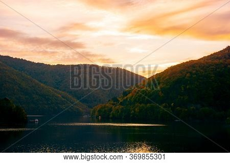 Sunset On The Tarnita Lake In Romania. Beautiful Nature Scenery In Autumn At Dusk. Gorgeous Sky With