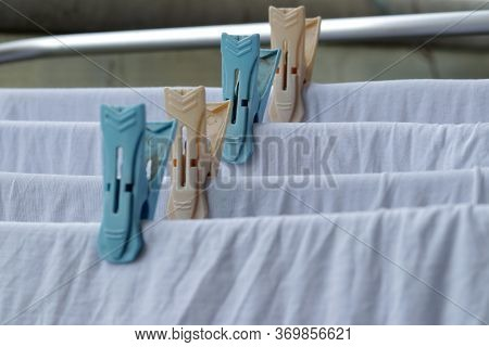 White Clothes Drying On Standing Clotheshores With Clothespins White Inner Wear On Rack Dryer Collap