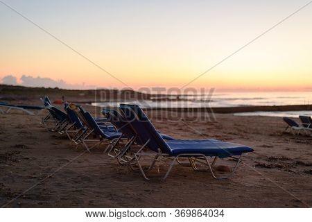 Old Chaise-longue Near Sea At Pink Calm Dusk