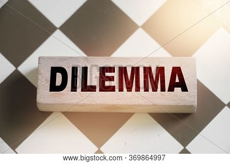 Dilemma Word Written On Wooden Block Put On Chess Board. Yes Or No Question Concept