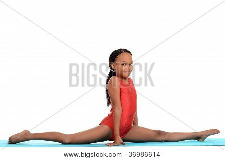 young female child doing gymnastics front split