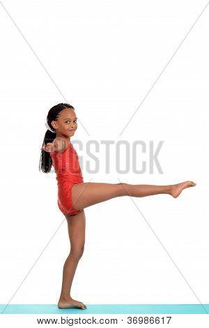 Young girl doing gymnastics balance move