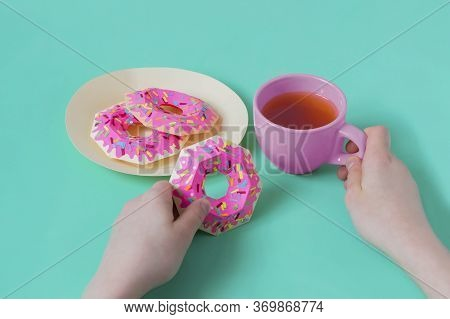 Hands Holding Real Cup Of Tea And Paper Donuts. Realistic Handmade Paper Objects. Paper Art And Craf