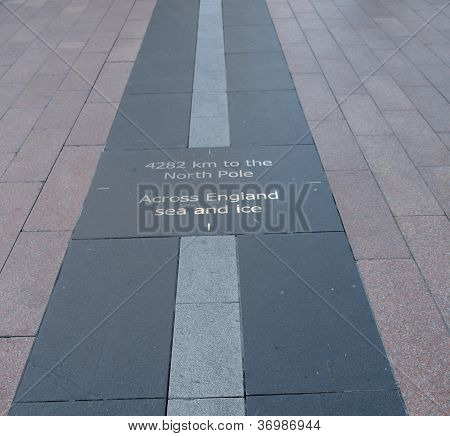 The prime meridian based at the Royal Observatory in Greenwich, marked by a floor strip at the Millennium Dome poster