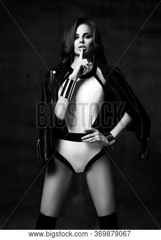 Black And White Portrait Of Young Beautiful Brunette Woman In Sexy Costume With High Boots And Leath
