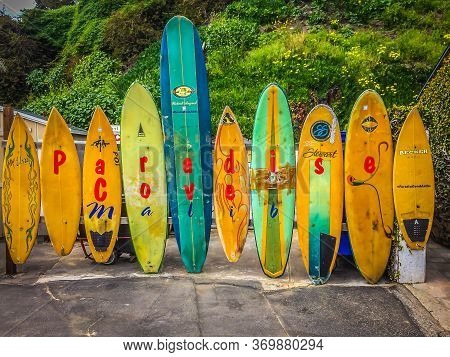 Malibu, Usa, March 2019, Line Up Of Colorful Surf Boards At Paradise Cove Beach, California