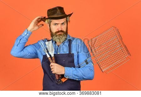 Spring Season. Bearded Hipster Wear Hat And Apron For Barbecue. Grilling Food. American Picnic. Fami