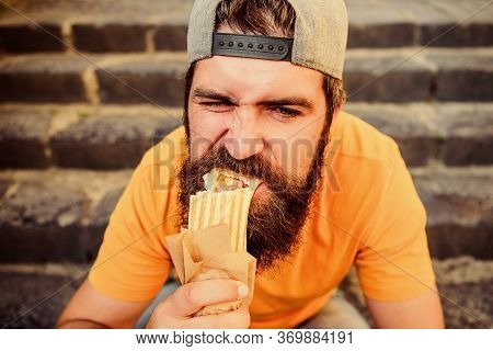 Junk Food. Guy Eating Hot Dog. Snack For Good Mood. Unleashed Appetite. Street Food Concept. Man Bea