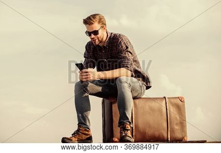 Handsome Traveler. Guy Outdoors With Vintage Suitcase. Transportation Facilities. Calling Taxi. Trav