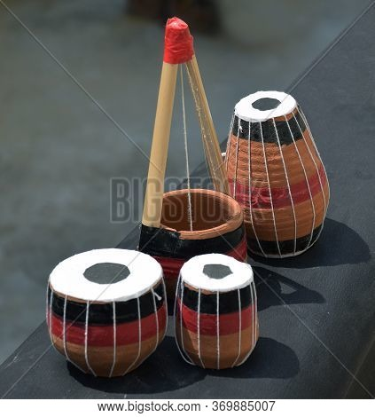 Miniature Version Of Indian Musical Instruments Consist Of Tabla, Pakhavaj And Ektara Which Are Made