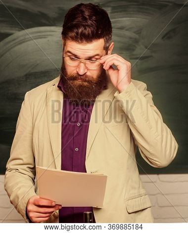 Mature Man At School. Back To School. Smart And Intelligent Look. Informal Education. Chemistry Conc
