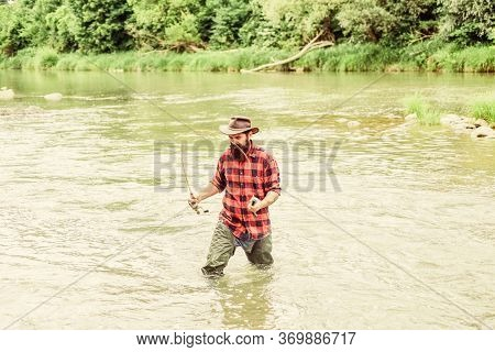 Fisher Masculine Hobby. Fish On Hook. Brutal Man Stand In River Water. Man Bearded Fisher. Fishing R