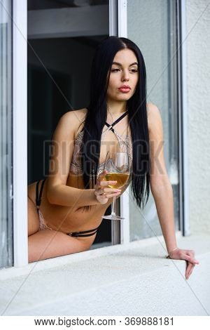 Staying At Home Could Be Fun. Sexy Girl Alcohol Cocktail. Hot Lady Erotic Lingerie Sit Window Sill.