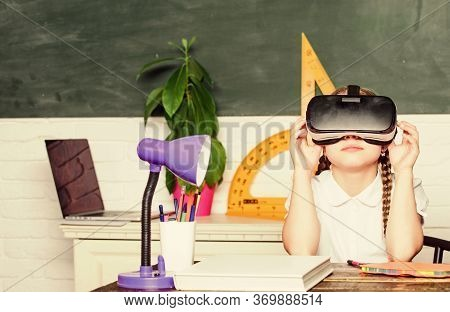 Virtual Education. Child Cute Pupil Wear Hmd Vr Glasses. Studying In Virtual Reality. Modern Technol