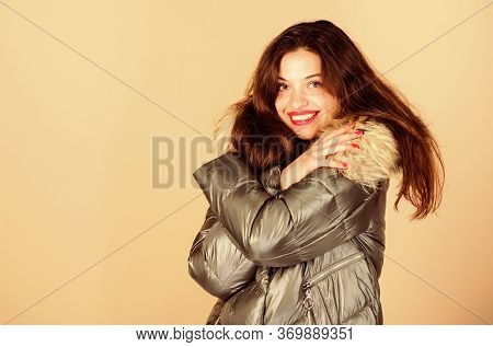 Holyday Atmosphere. Woman In Padded Warm Coat. Girl In Puffed Coat. Faux Fur Fashion. Flu And Cold.