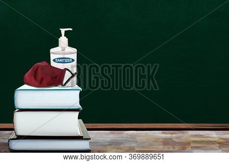 Education Concept Of New Normal In Schools During Covid-19 Pandemic With Classroom Setting Of Books,