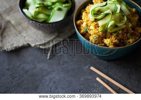 Traditional Burmese Or Myanmar Fried Rice With Shallots, Turmeric And Fresh Cucumber Strips With Cho