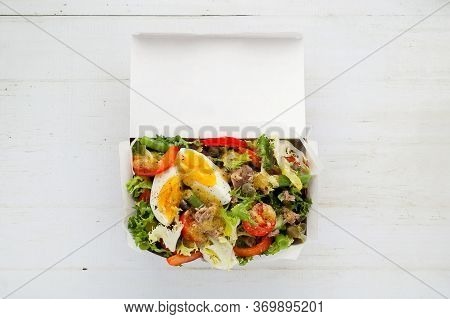 Nicoise Salad With Tuna In Paper Box On White Background With Copy Space Flat Lay.take Away Of Natur