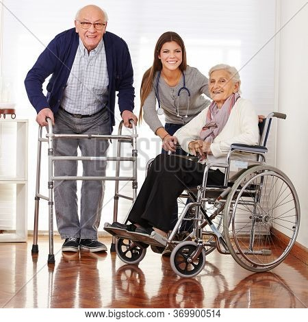 Elderly care assistant with two seniors in a wheelchair and a walking frame