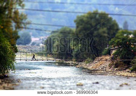 Tilt-shift Effect Photo Of Bridge Across Tisa River In Rahiv, Ukraine