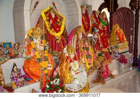 Colorful Hindu Gods Hung With Flowers In A Hindu Temple. World Tourism, Wedding, Marriage.