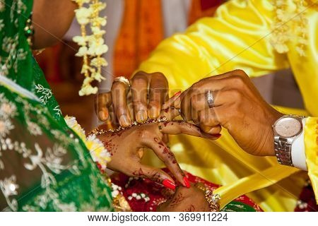 The Groom Places The Wedding Ring On The Finger Of The Bride. Indian Wedding, World Tourism.