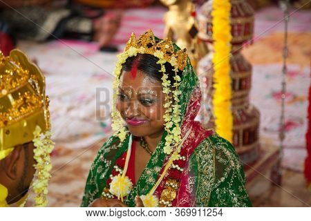 A Happy Bride Smiles At Her Fiance At A Wedding Ceremony In A Hindu Temple. Indian Wedding Celebrati