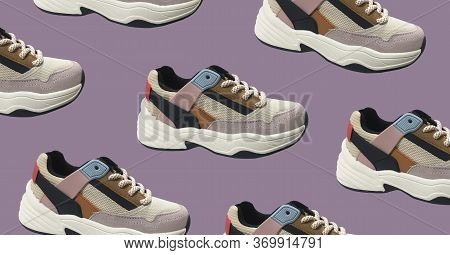 White Platform Sneakers With Bright Color Accents Pattern On Purple Background. Close View Of Fashio