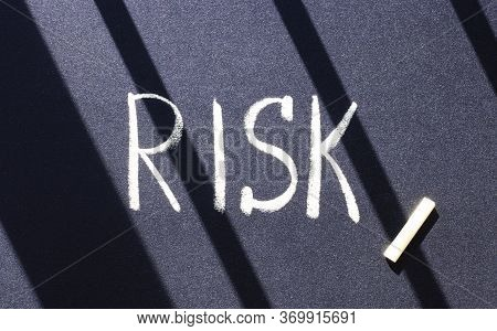 Black Surface With White Chalk Inscription Risk. Risk Management, Cost Estimation, Business And Inve