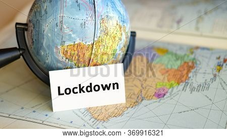 Lockdown Tour - Text On A White Sheet On Globe On The Blue Background Of The Atlas Map