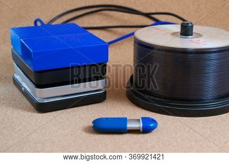 Digital Data Backup Devices: External Usb Hard Drives,  Memory Stick And Cds On Cork Background