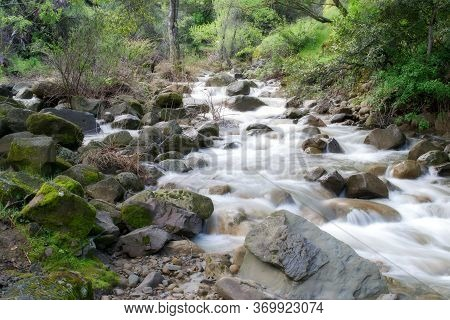 Long Exposure Of Water Running Down A Putah Creek Tributary In Winters, California, Usa, After The P