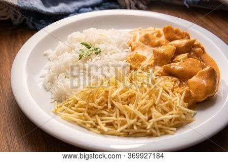 Chicken Strogonoff With Rice And French Fries (potato Sticks) On Dish. Chicken Stroganoff, Is A Dish