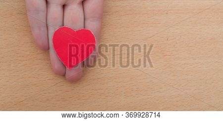 Hand Holding A Red Heart, Health Insurance, Organ Donor Day, Charity, Foster Family Concept