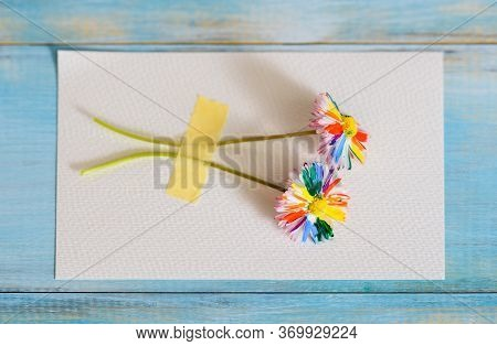 Multi-colored Drawing By Paints. Rainbow Flower, Multi-colored Daisy. On A Blue Background.bright Ca