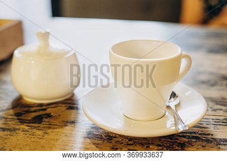 Aromatic Fresh Coffee In A White Cup. Espresso In A Small White Cup And A Sugar Bowl In A Summer Caf